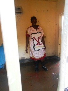 Mary stands in her former bedroom which she was forced to vacate because of the floods