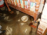 The floor in her bedroom is relatively dry because the cement there was put there in the dry season